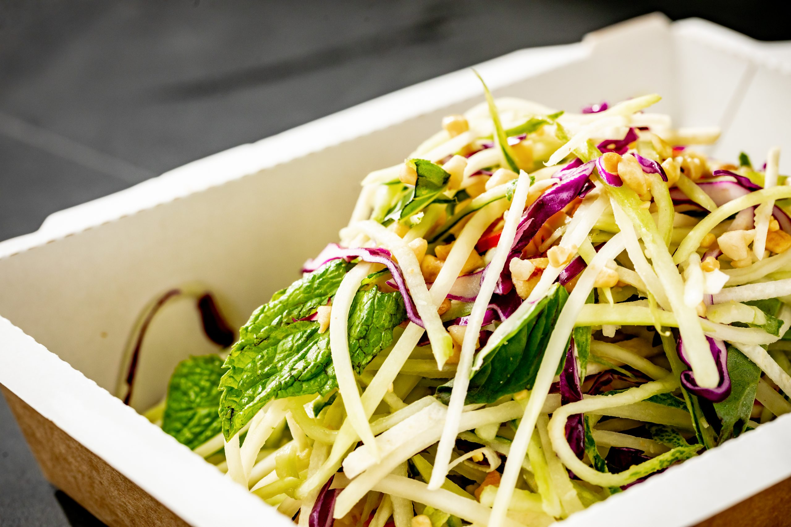 close up of a salad in a to-go container from E&O Kitchen