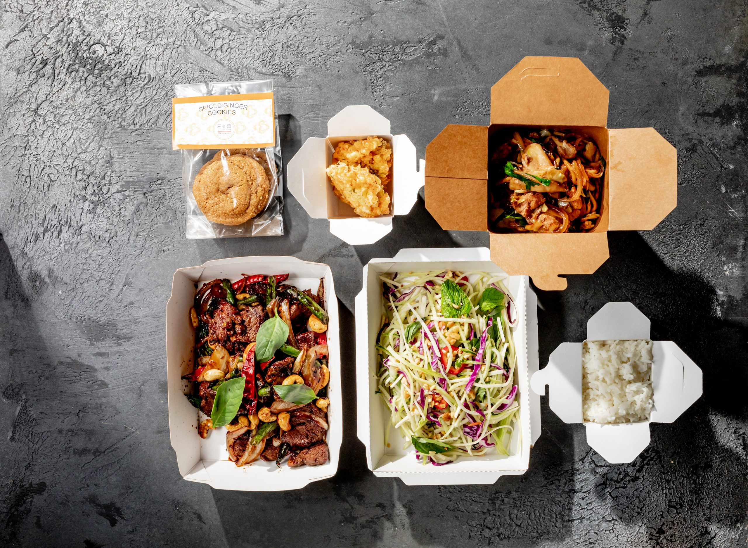 an aerial view of to-go meals from E&O Kitchen