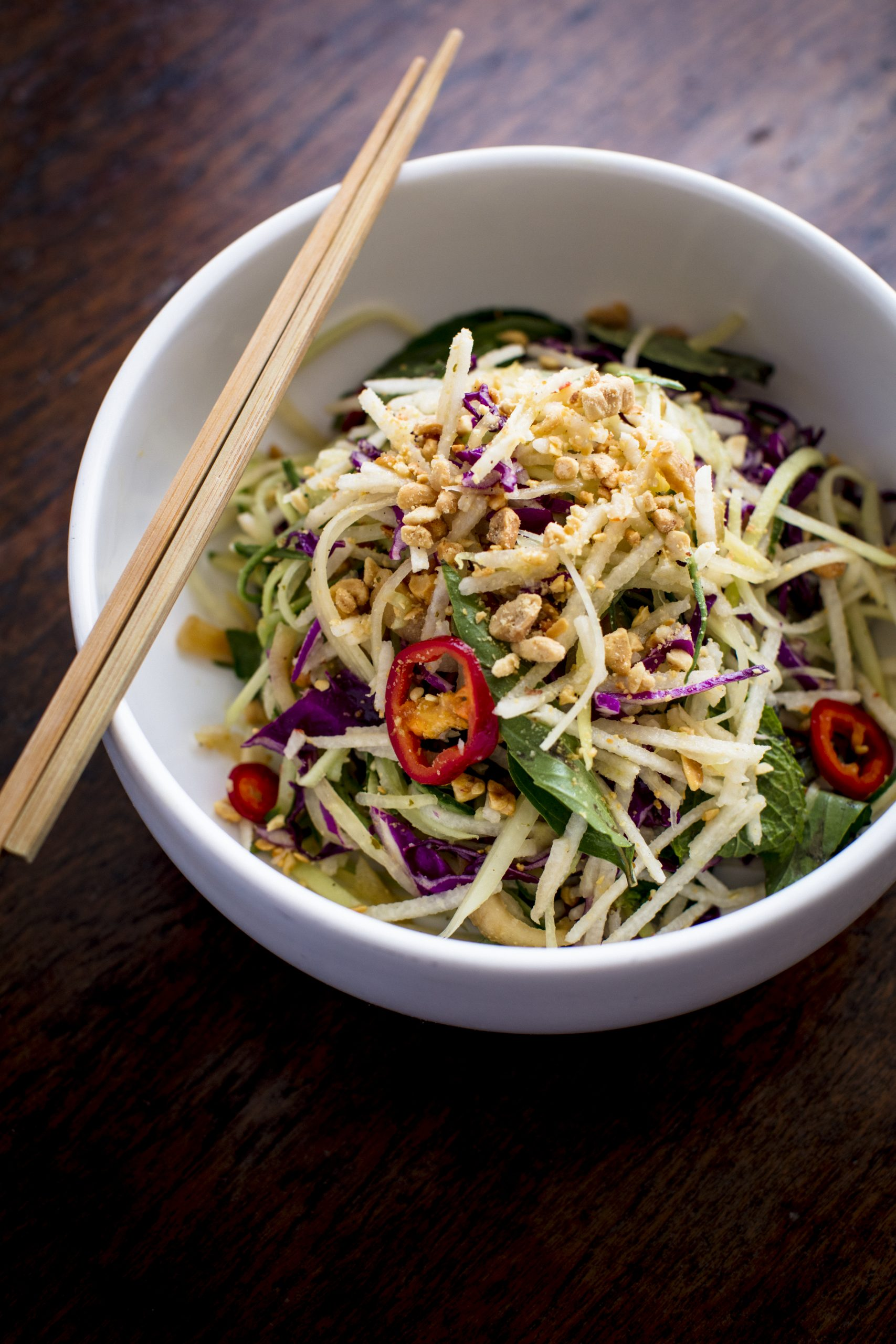 salad in a bowl with chopsticks